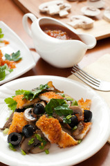 Salad with mushrooms, olives and chicken breast