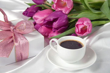 Fresh tulips with gift box and coffee breakfast