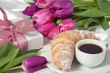 Breakfast, gift box and tulips on white silk