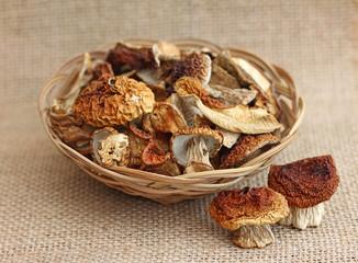 Dried mushrooms in wicker basket