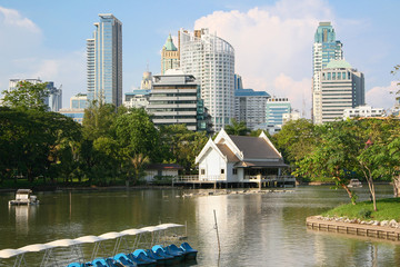 Skyscrapers and garden pond. Lumphini Park Bangkok