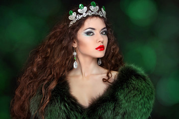 Beautiful woman in luxury fur coat. Jewelry and Beauty. Fashion