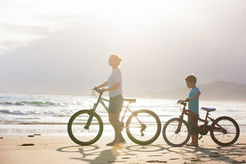Fototapete - Mother and son with bikes