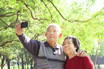 Senior couple taking picture of themselves outdoor