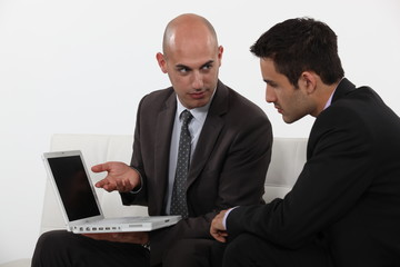 Businessman explaining his work to colleague