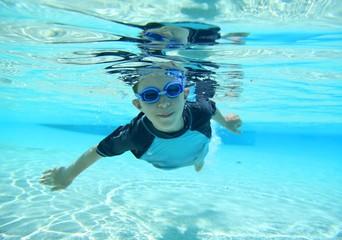 Boy swimming, underwater shot