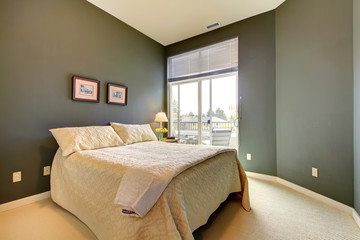 Bedroom wiht grey green walls and white bedding.