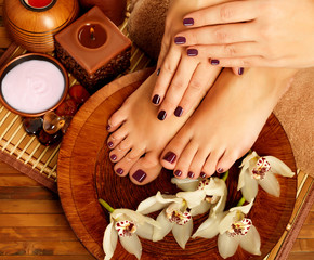 Wall Murals Pedicure female feet at spa salon on pedicure procedure