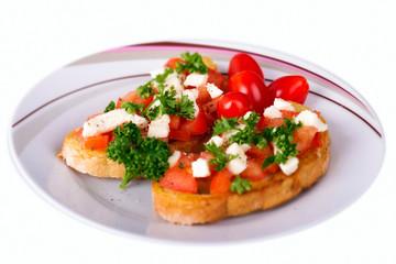Bruschezza mit Schafskäse und Tomaten