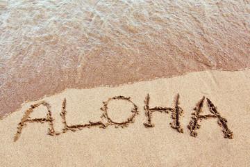 Aloha written on a Hawaiian beach