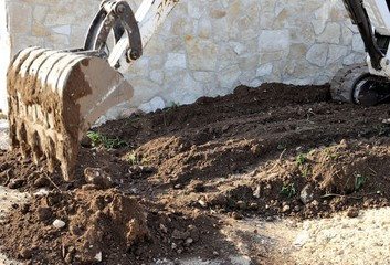 excavator system vegetal soil of road embankment