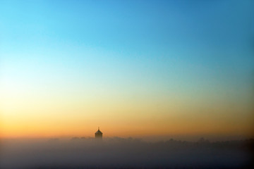 church tower on foggy winter evening