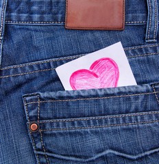 Valentines day card in jeans pocket