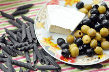 Brie cheese and olives on a plate
