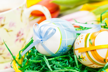 Easter eggs with tulips and cup of coffee. Easter background