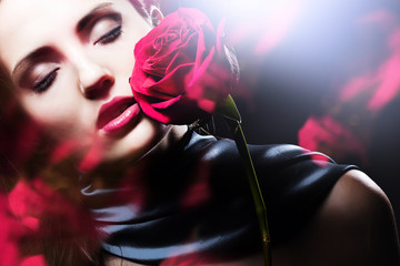 attractive woman with red rose