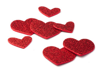 Red shiny hearts on white background