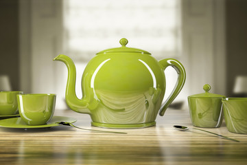 Green teapot and teacups