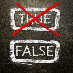 True or false written on a blackboard with white chalk.