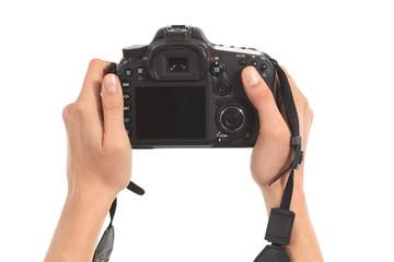 Beautiful woman hands holding a dslr camera