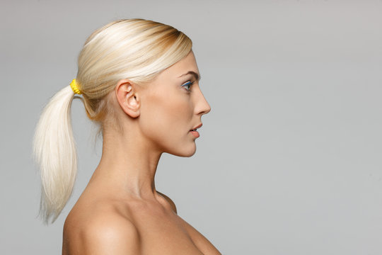 Side view closeup of beautiful blond woman looking forward