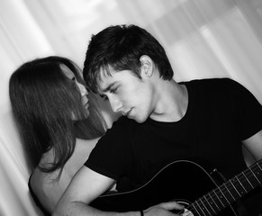 man with guitar, woman