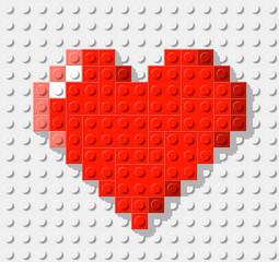 Heart made from plastic construction blocks