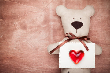 Vintage valentine card  with handmade bear and heart on wood