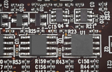 Close up of a printed brown computer circuit board