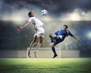Aluminium Prints Football two football players striking the ball