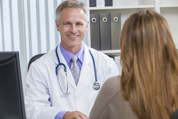 Male Hospital Doctor Talking to Female Patient