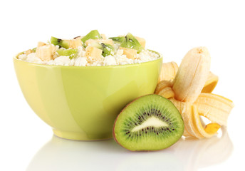 Cottage cheese in color bowl with exotic fruits, isolated