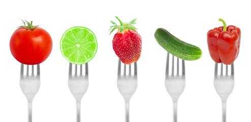 Diet concept, fruit and vegetables on forks