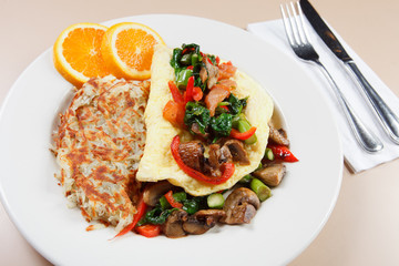 Southwestern style omelet with hash browns