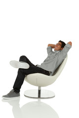 Young adult relaxing in a chair