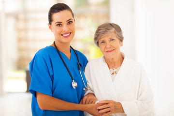 senior woman and caring young nurse