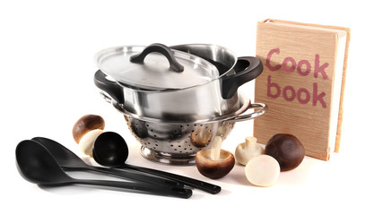 composition of kitchen tools,cook book and mushrooms isolated