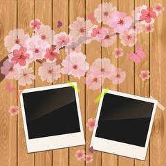 photo frame on wooden texture with cherry flowers