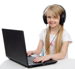 girl in headphones with a laptop. isolated on white