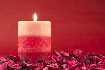 Candle on red background