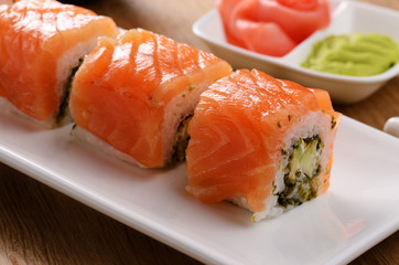 Mixed sushi on a white plate with wasabi and  ginger