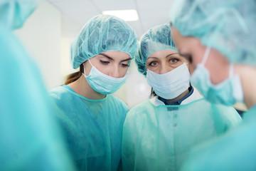 Doctors preparing for surgery