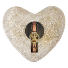 Stone heart shape with a keyhole isolated on white