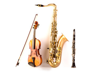 Sax tenor saxophone violin and clarinet in white