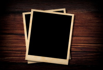 blank old photo on wooden background