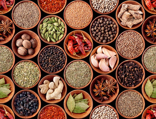 Seamless texture with spices and herbs over black