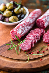 Spanish salami with rosemary and olives