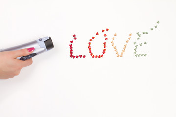 Hand, hairdryer and love