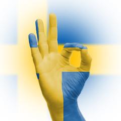 hand OK sign with Swedish flag