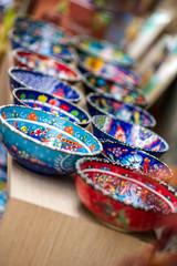 Small colorful pottery bowls in a row